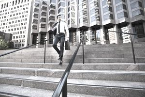 a businessman walking down steps by an office building