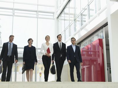 Business professionals walking in office building