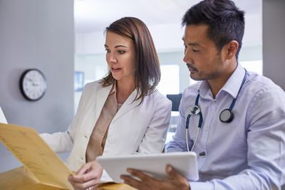 Doctors discussing patient record