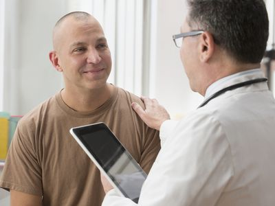 Military service member seeing a doctor.