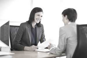 A woman conducts a job interview