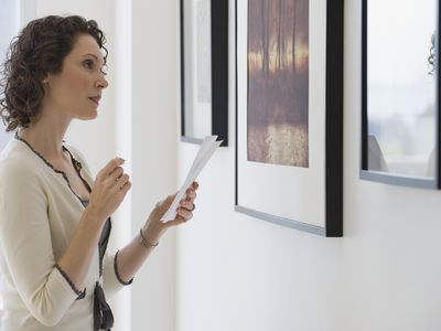 Woman looking at art in an art gallery.