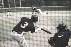 Baseball player hitting the ball