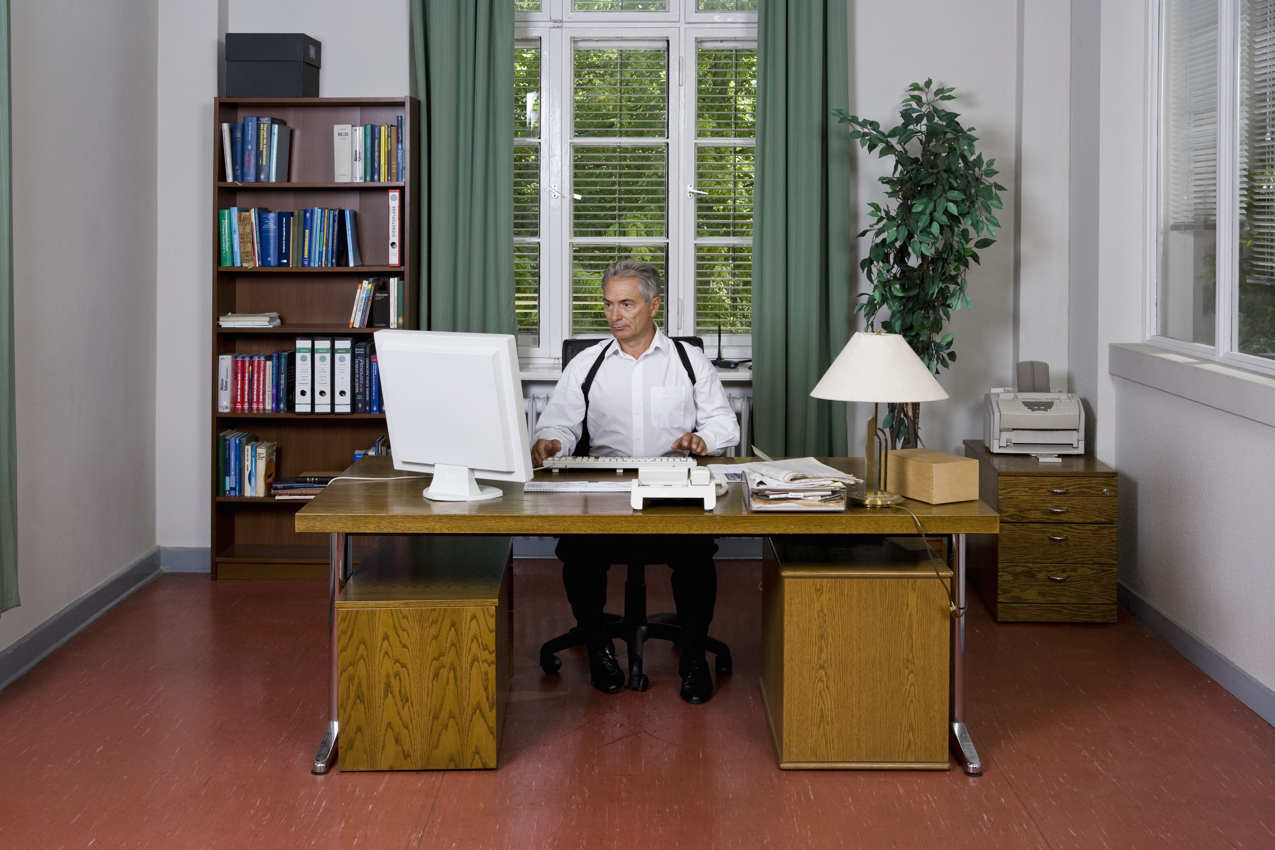 A police officer doing paperwork in an office