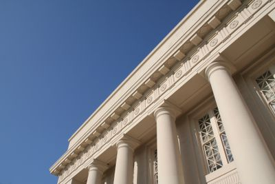 Close up shot of the exterior of a bank building.