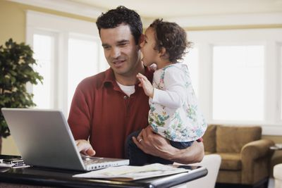 A man is working from home on his flexible work schedule.