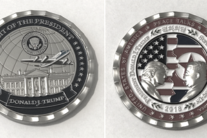 Front and back of a Trump military challenge coin